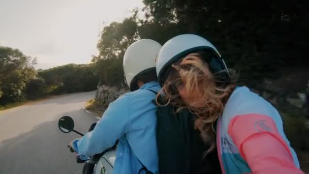 Young couple rides motorcycle together