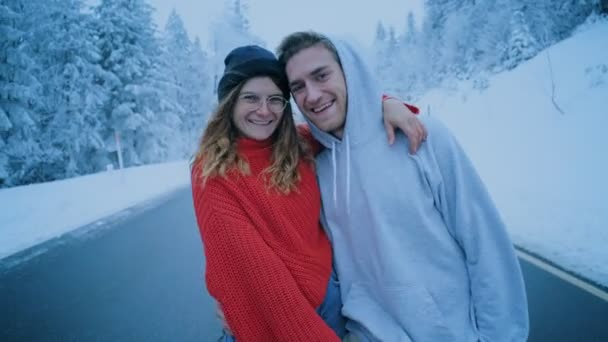 Couple in love laughs and kisses in winter