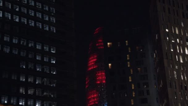 Office tower skyscraper lit up at night
