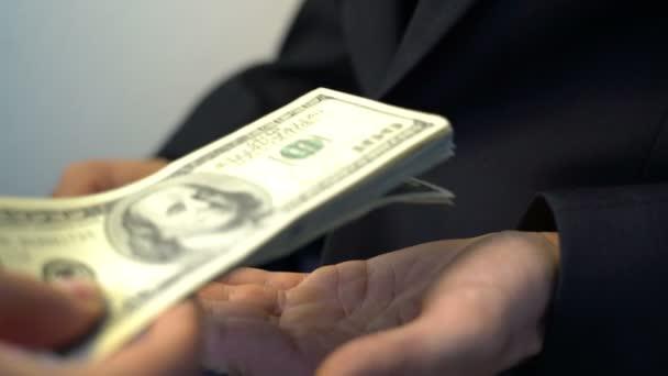 man getting pile of money bribe crime corruption concept