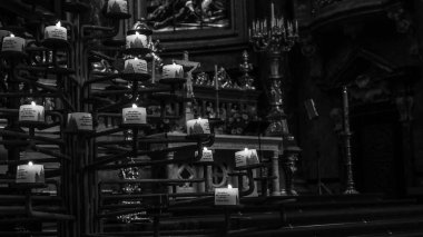 February 2018: Detail, in black and white, of the votive candles of the Berliner Dom. Lighting is scarce but natural February 2017 in Berlin