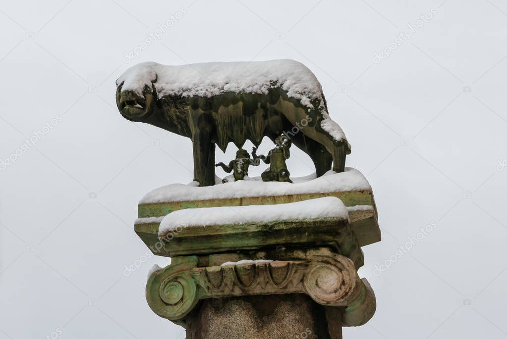 Winter in Rome. Legendary Capitoline Wolf with royal twins, symbol of the city, at the top of Capitol Hill, covered with snow.