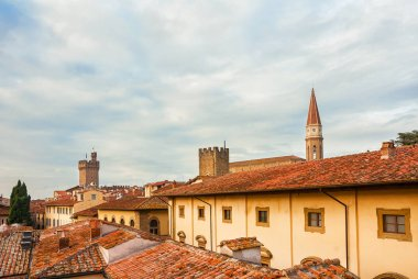 View of Arezzo historic center skyline with old towers, cathedral gothic belfry and characteristic red roof tiles