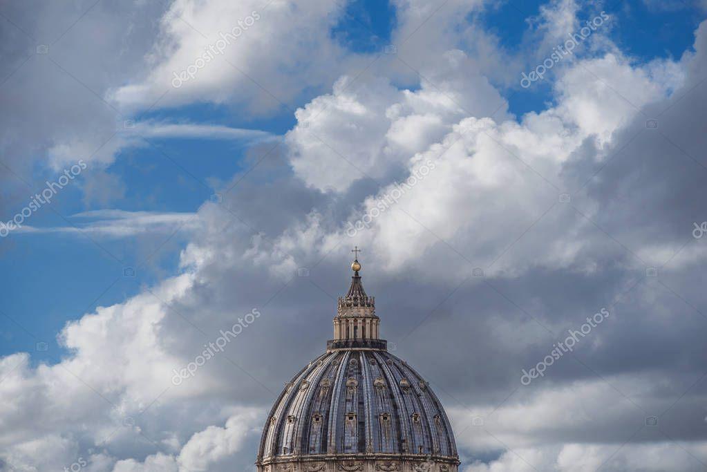 Wondwrful Saint Peter Dome in Rome, symbol of Roman Catholic Church, among clouds