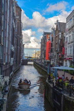 Amsterdam, The Netherlands, August 15th 2014: Channel in Amsterdam Netherlands houses river Amstel landmark old european city spring landscape