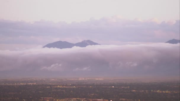 Panning shot of the Salt Lake Valley with clouds clinging to the mountains.