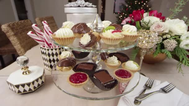Close up track shot of a variety of desserts decoratively displayed for a Holiday/Christmas party