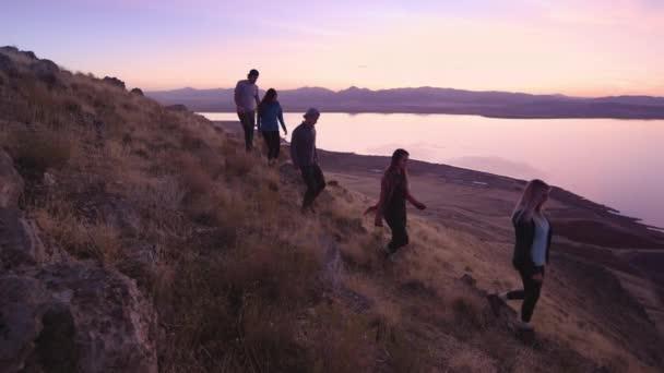 Group of teenager friends walking in mounatins