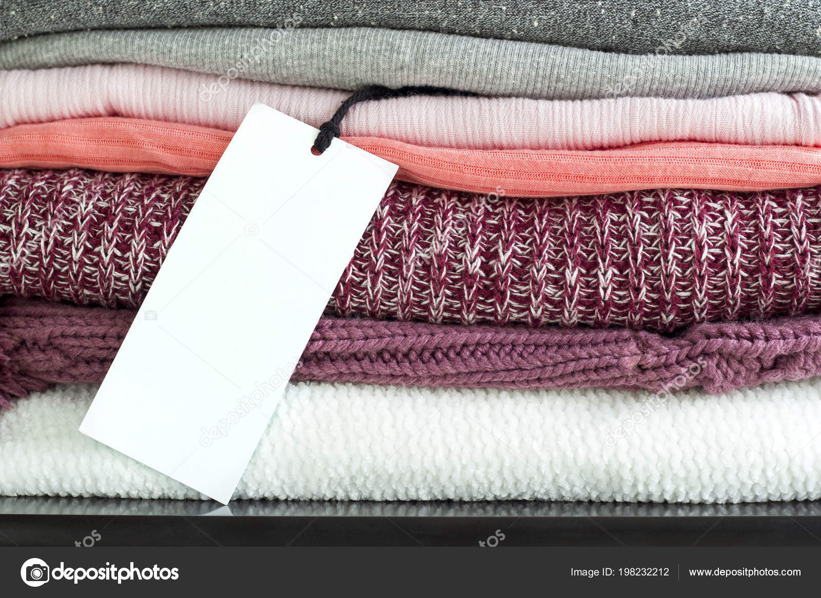 Label White Price Tag Stack Folded Colorful Clothes Mockup