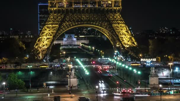 Paris, France - November 3, 2017:Splendid timelapse of Eiffel Tower illuminated with sparkling yellow light, with lines of cars rushing under it at night in autumn.