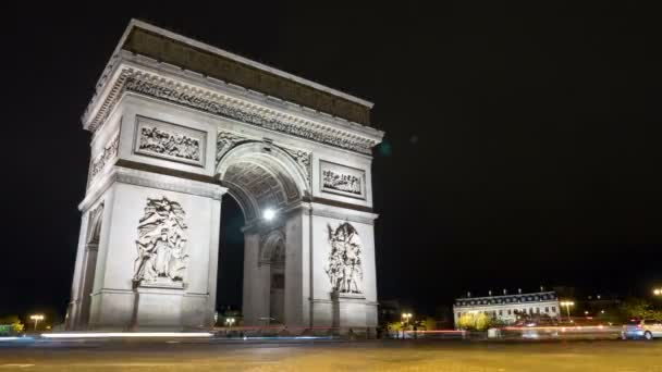 Paris, France - November 3, 2017:Exciting timelapse view of famous Arc de Triomphe in Paris on the right bank of the Seine at dark night in the  autumn. It looks fine.