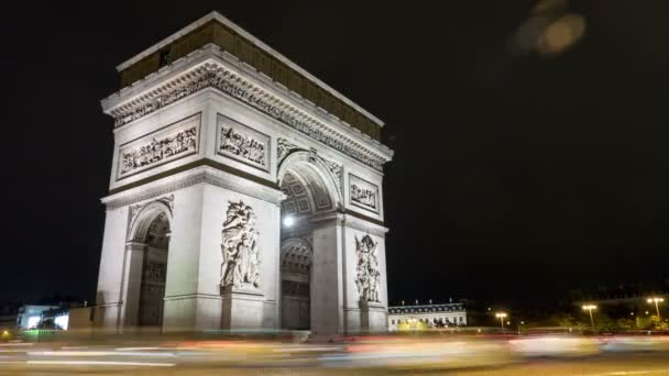 Paris, France - November 3, 2017:Gorgeous timelapse view of famous Arc de Triomphe in Paris on the right bank of the Seine at deep night in the  autumn. It looks great.