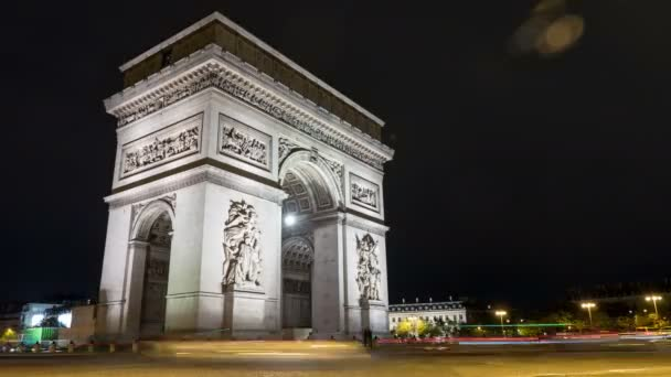 Paris, France - November 3, 2017:Astonishing timelapse shot of Arc de Triomphe in Paris at the center of Place Charles de Gaulle at dark night in autumn. It looks great..