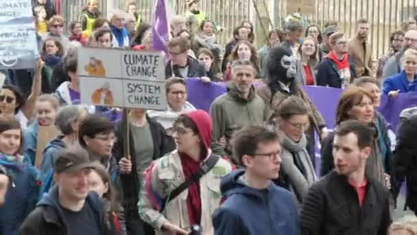 Brussels, Belgium - March 30, 2019: Cheerful view of a big demonstration of young green activists marching with banners climate change and system change in Brussels in spring