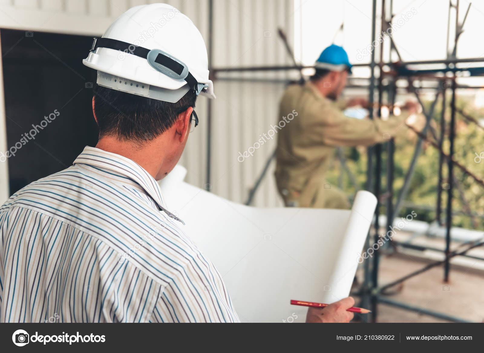 Senior Civil Engineer Reading Drawing Blueprint Supervision
