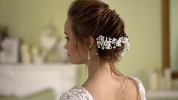 Bride hairstyle with decoration. Beautiful naked back.
