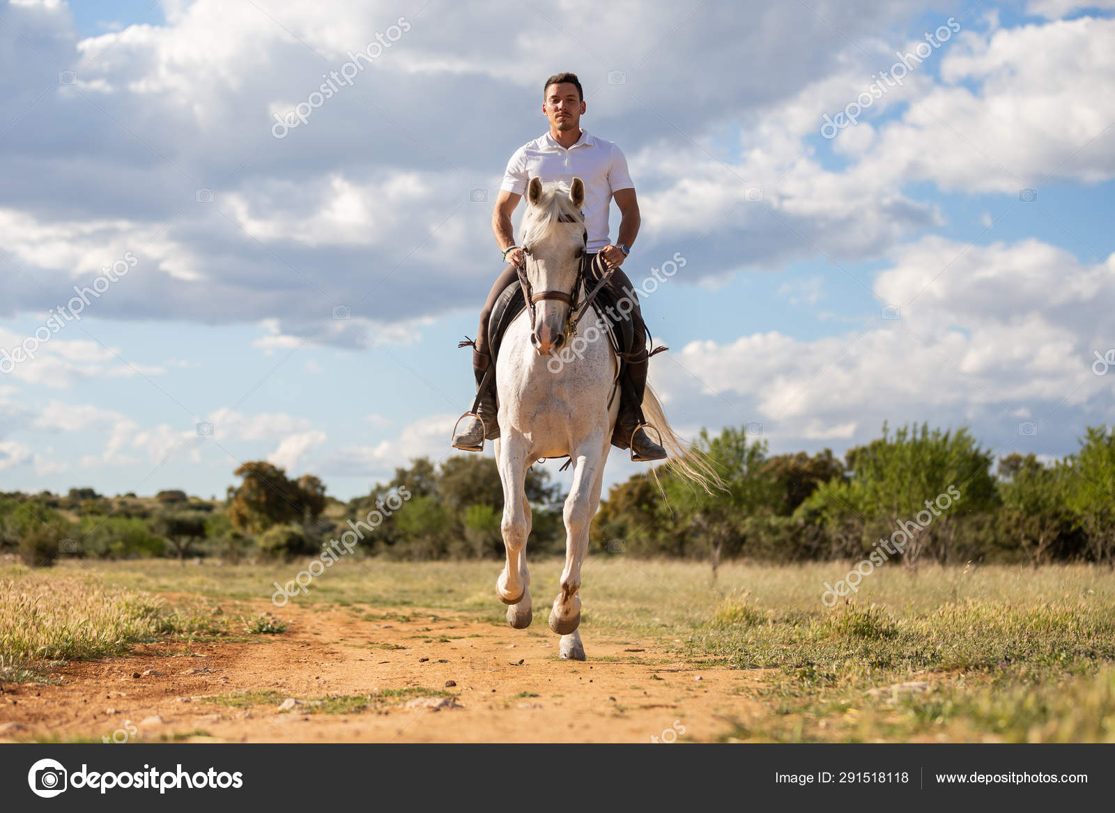 Young Guy Casual Outfit Riding White Horse Sandy Road Stock Photo C Pablobenii 291518118