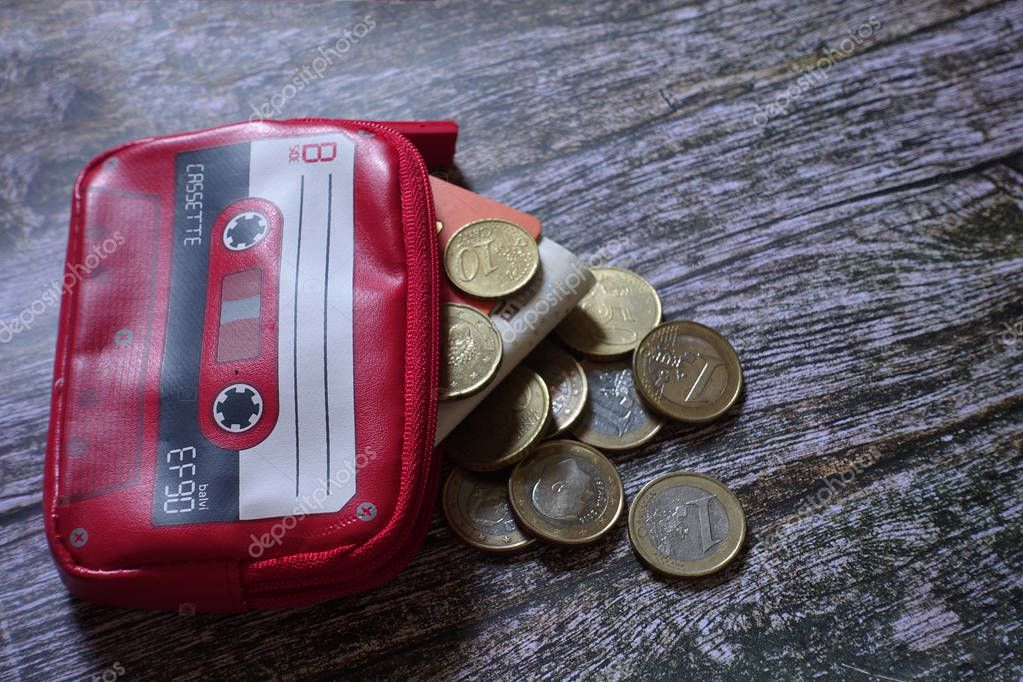 Purse with cassette shape on top of a wooden table