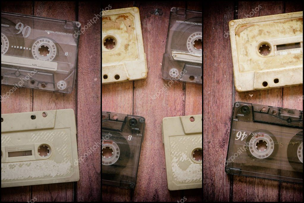 Old cassette tapes on the wooden brown table