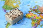 Fotografie Mapa světa a kufr. Cestování a cestovní ruch