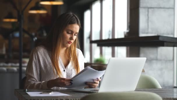 woman with red lips working with her laptop and checking the document