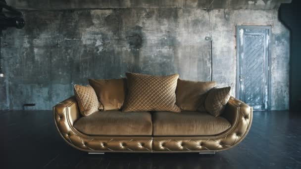luxury quilted sofa in the Studio in gold color
