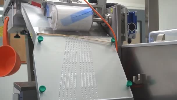 Process of production of pills, tablets. Industrial pharmaceutical concept. Factory equipment and machine.
