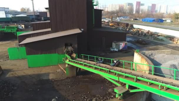Long conveyor belt transporting metal