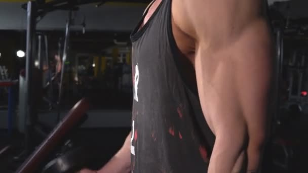 Man in gym holding dumbbell close up