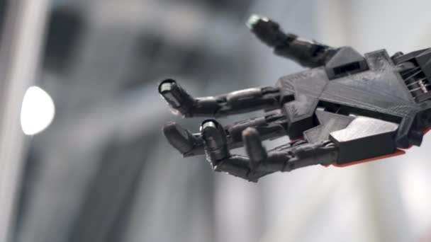 Future is now. Male hand of young student scientist inventor shakes robotic arm.