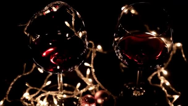 Two glasses of red wine with The blinking holiday lights