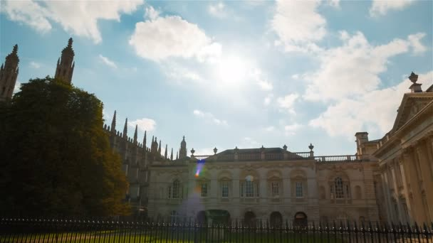 CAMBRIDGE, circa 2018 - Wide panning shot of the Kings College and University in Cambridge, England, UK shot against the sun, clouds and a blue sky.