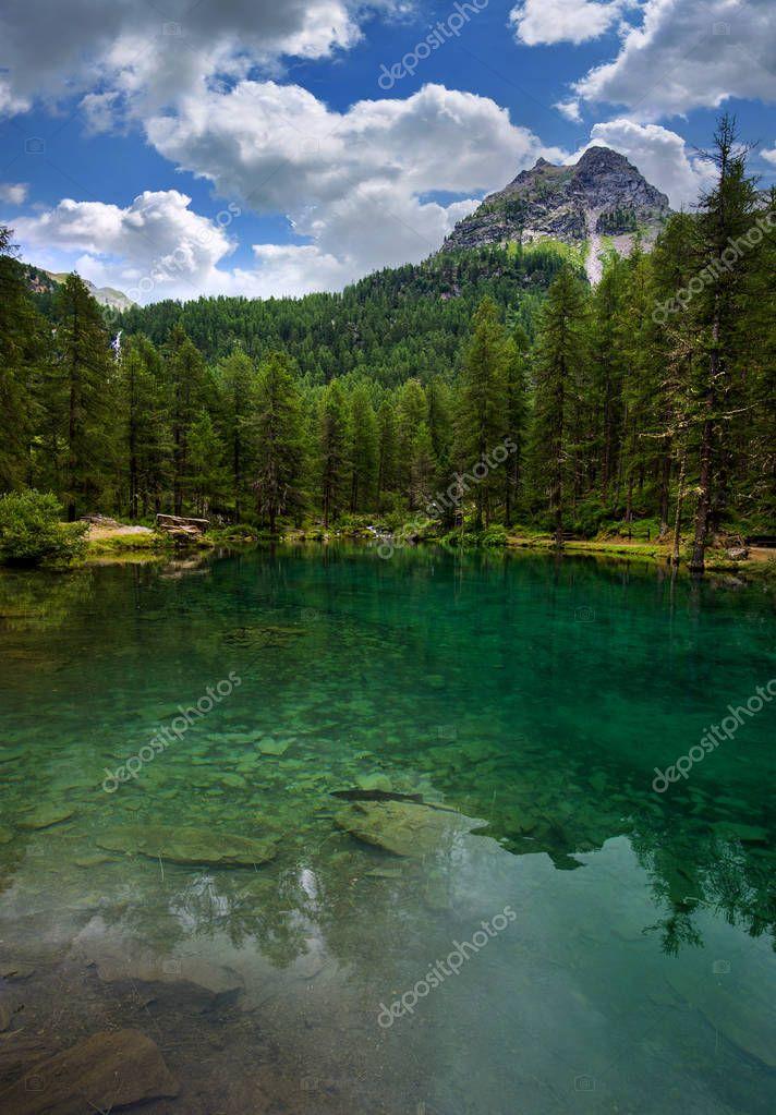 Mountain green lake landscape. alpine lake Pellaud in Rhemes Notre Dame, Valle dAosta, Italy