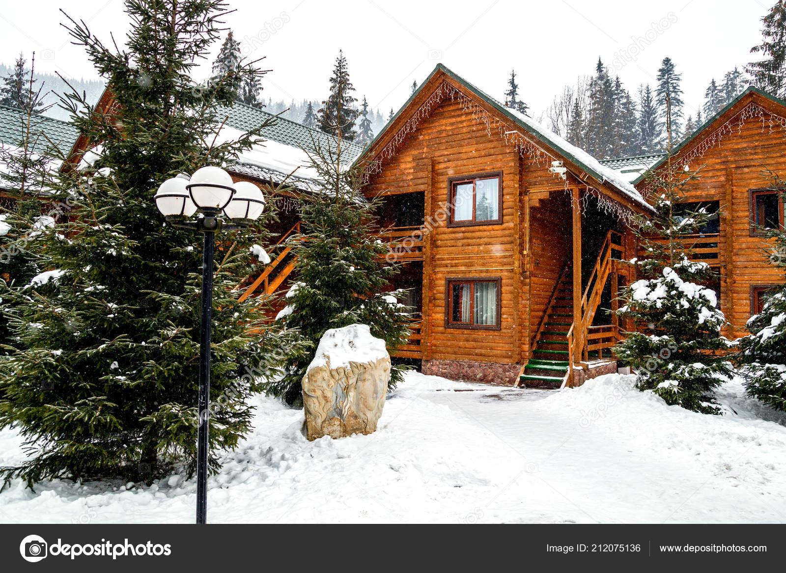 wooden cottage house mountain resort christmas winter landscape