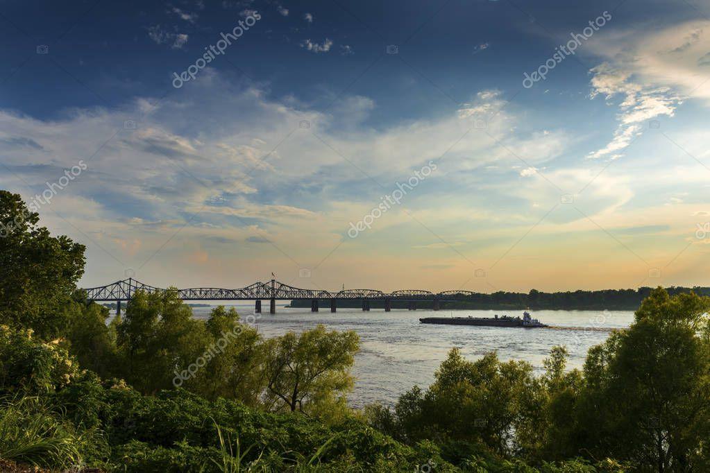 Boat in the Mississippi River near the Vicksburg Bridge in Vicksburg at sunset, Mississippi, USA
