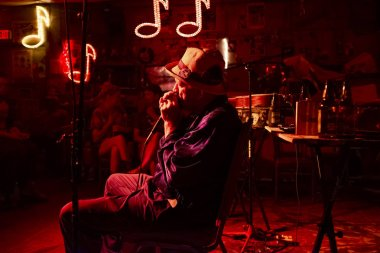 Clarksdale, Mississippi, USA - June 23, 2014: Blues musician playing at the Reds Lounge in Clarksdale, Mississippi, USA.