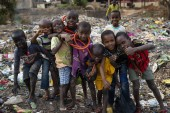 Bissau, Republic of Guinea-Bissau - February 8, 2018: Group of children at a landfill in the city of Bissau, in Guinea-Bissau, West Africa