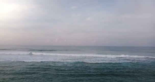 Aerial drone view of high waves in beautiful sunset ocean. Breathtaking open ocean, cloudy sky and horizon panorama.
