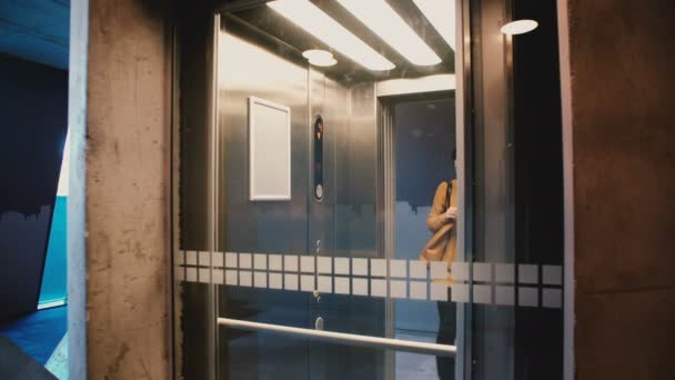 Young happy girl enters elevator, pushes the button, door closes and she rides up using smartphone app and smiling.