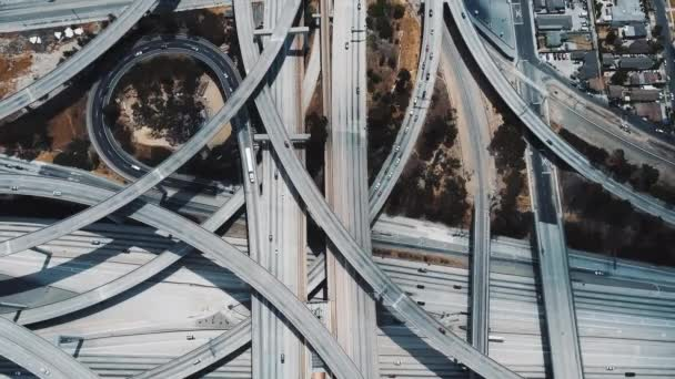 Drone lockdown shot of amazing busy highway interchange with multiple level flyovers and junctions in Los Angeles, USA.