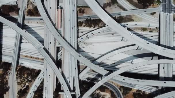 Drone flying right revealing amazing highway junction interchange with complex roads, levels and flyovers structure.