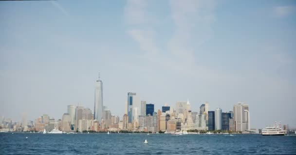 Timelapse of New York, Manhattan downtown skyline. 4K. Boats passing by on River Hudson. Amazing megapolis cityscape.