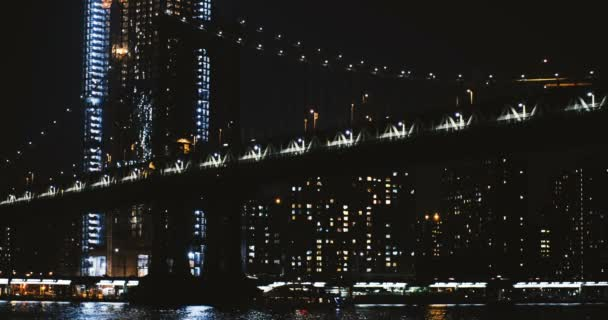 Night Manhattan Bridge timelapse 4K New York. Low angle view of suspension cable structure yield. Architecture landmark.