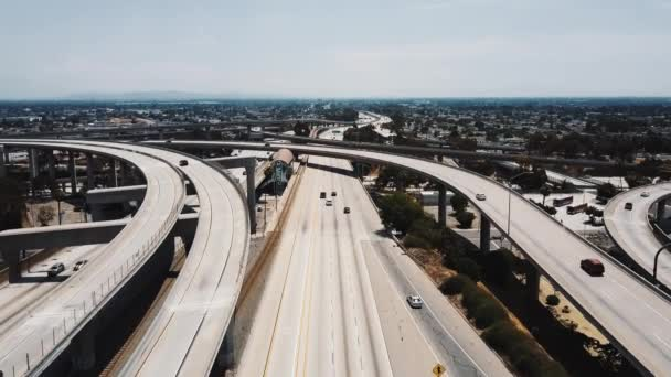 Drone flying over famous Judge Pregerson freeway junction in Los Angeles, California with a metro station in the middle.