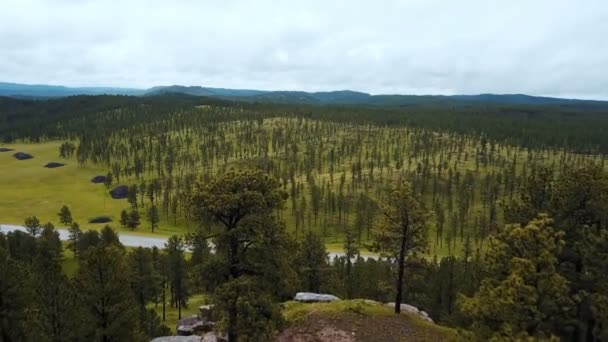 Epic aerial drone shot of large tree covered rocky hills revealing incredible national park forest landscape skyline.