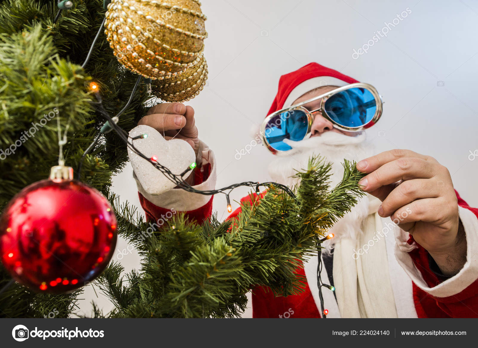 cute hipster santa claus on white background new year and christmas celebration concept photo by denissmile