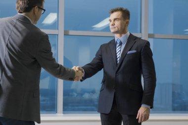 Good deal. two businessmen hands shaking