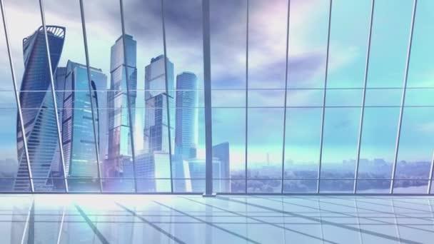 Panorama velké kanceláře s mrakodrapy na pozadí.