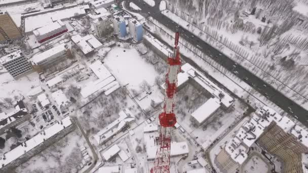 amazing drone flight over a modern telecommunication tower, buildings and roads