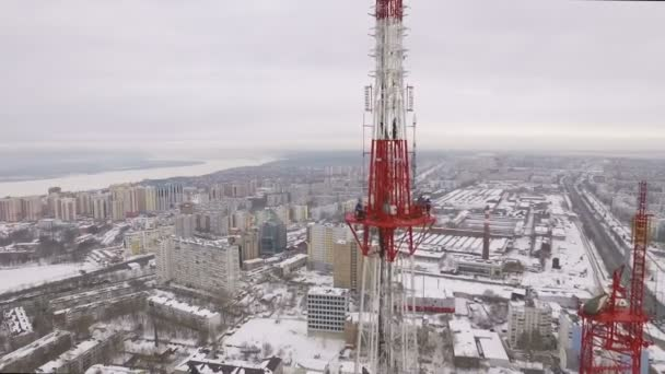 aerial panorama of large city and Telecommunications tower, radio and tv broadcasting